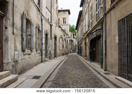 Street in historical centre of Avignon. Avignon is a famous and very popular among tourists city in Provence in south of France