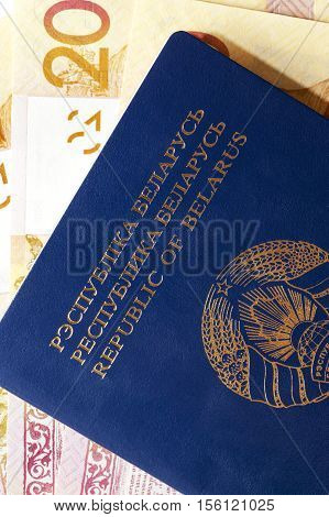 photographed closeup Belarusian passport and money lying in the document