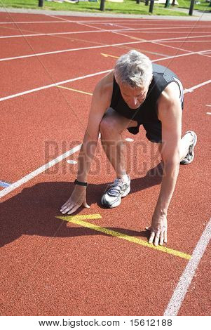 man is starting for the run at the athletics-place