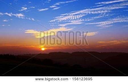 Colorful dramatic sky with cloud at sunset.Sky with sun background in mountains, sunrise.