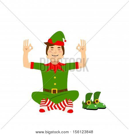 Christmas Elf Meditates. Xmas Yoga. Assistant Santa Claus Lotus Posture. Little Man In Green Suit. C