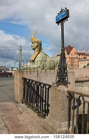 St. Petersburg Russia - 14 July 2016: Cast-iron Sphinx at the Egyptian bridge over the Fontanka River. In the architecture of the bridge was reflected typical for the beginning of XIX century interest in the art of ancient Egypt