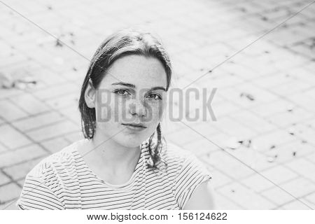 Beautiful Woman Face Portrait Freckles. Outdoor Shot. Black And White.