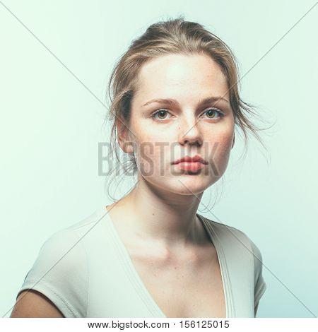 Beautiful Woman Freckles Face Portrait Young. Light Background. Studio Shot.
