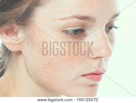 Beautiful Face Woman Freckles And Curly Fly Hair. Studio Shot.