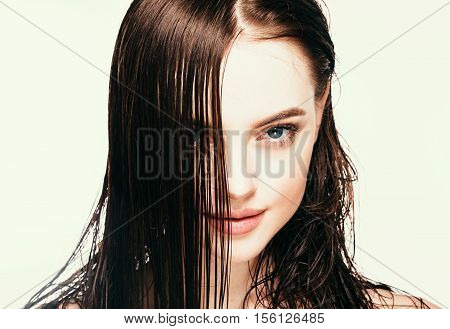 Beautiful Brunette Woman Portrait. Hair Concept. Studio Shot. Isolated On White.