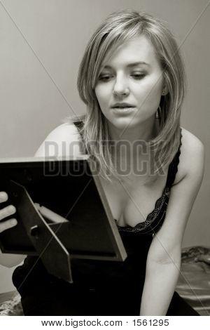 Woman Looking At Photo