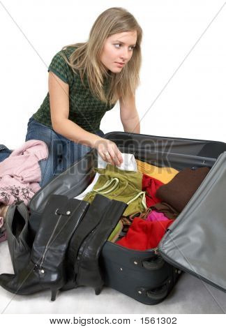 Girl Is Packing Clothes