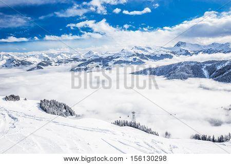 Cable car goes through thick fog in Kitzbuhel ski resort, Tyrolian Alps, Austria