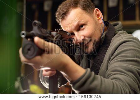 The man at the shooting range .