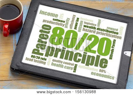 Pareto principle or eighty-twenty rule - word cloud on a digital tablet with a cup of coffee