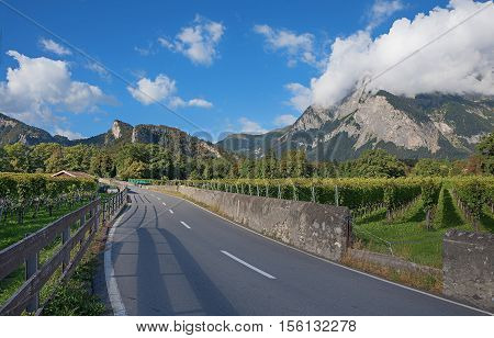 country road through heidi land swiss alps canton grisons maienfeld