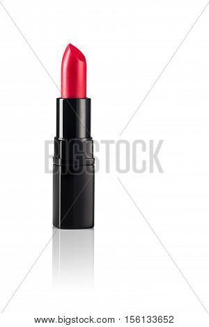 Red lipstick on white, reflective, mirror background. Concept for cosmetic or beauty advertising with ample copyspace.