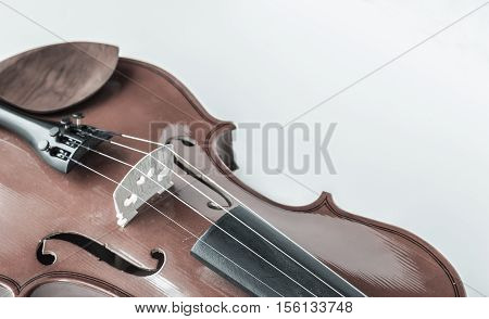 horizontal image of a violin placed across one corner of the composition which has a filter applied to the image isolated on white background.