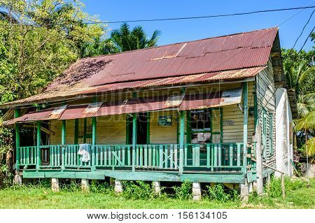 Livingston, Guatemala - August 31 2016: Typical raised wooden house with corrugated iron roof in Caribbean town of Livingston, Guatemala