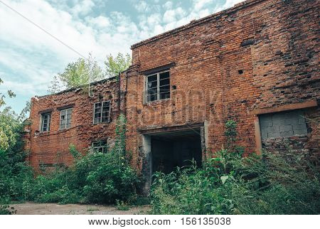 Abandoned Industrial Buildings from red bricks. Ruined car workshop