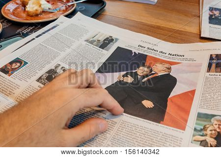 FRANKFURT, GERMANY- - NOV 10 2016: Man reading about Barron Trump and Donald Trump after US elections in Frankfurter Allgemeine Zeitung newspapper with Donald Trump elected as President as the 45th President of United States of America