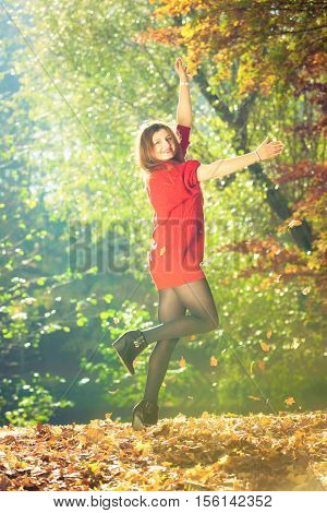 Young Woman Tossing Leaves.