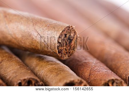 Close up view of chocolate cigars as background.