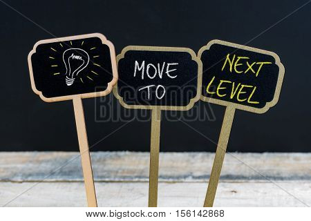 Concept Message Move To Next Level And Light Bulb As Symbol For Idea