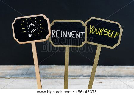 Concept Message Reinvent Yourself And Light Bulb As Symbol For Idea