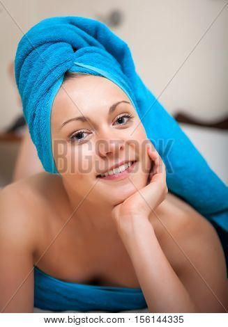 Pretty Young Woman With Blue Towel, Posing