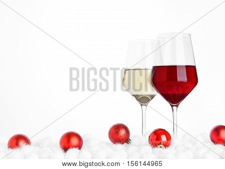 Glasses of red and white wine christmas with balls on white background