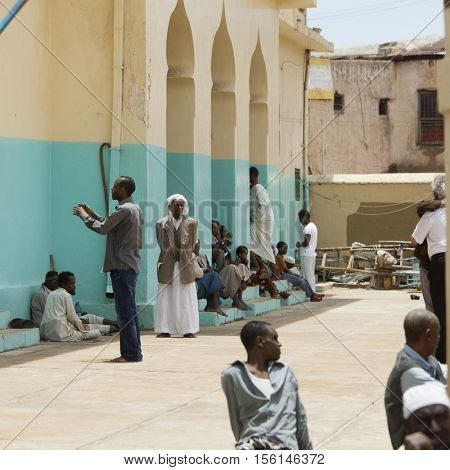 HARAR, ETHIOPIA-APRIL 17, 2015: People worship at the Aw Abdal Mosque, largest mosque in the holy city of Harar, Ethiopia