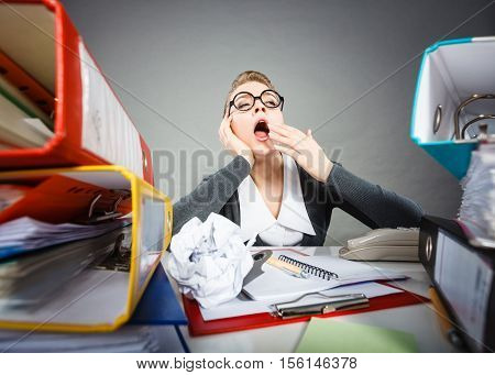 Paperwork job corporation lazy slow boring concept. Bored office employee at work. Female nerdy bureau clerk at desk.