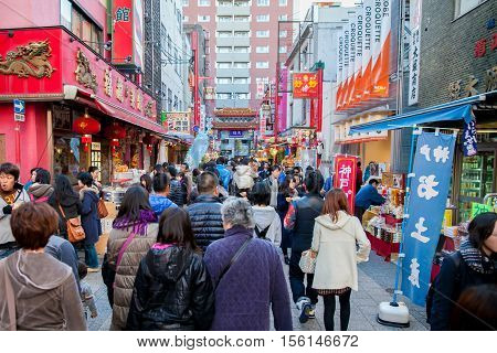 KOBE - NOVEMBER 25: Daytime at Chinatown on November 25 2012 in Kobe Japan. Nankinmachi originated in 1868 when Kobe's port was opened to foreigners including Chinese immigrants from Canton Fukien and Samgong.