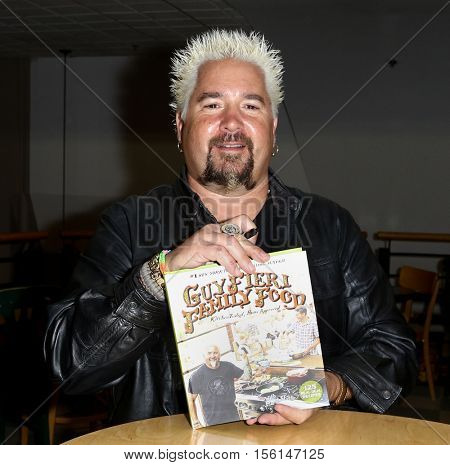 HUNTINGTON, NY-OCT 11: Chef Guy Fieri signs copies of his book