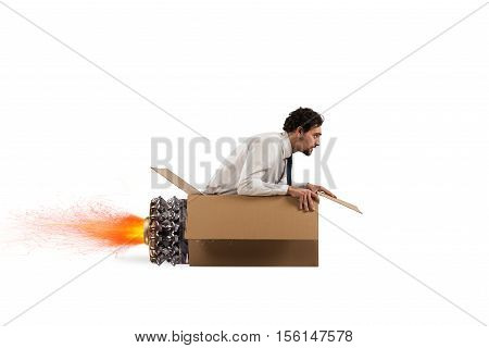 Creative man fly and plays with his cardboard missile