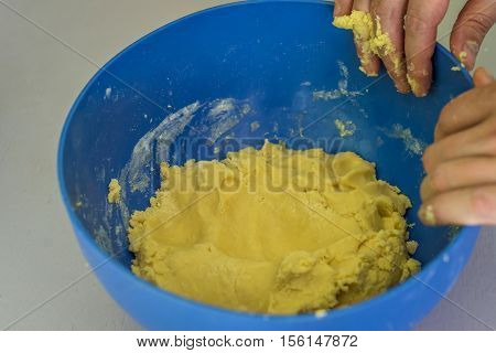 ready-made shortcrust pastry in a blue bowl