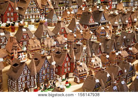 STRASSBOURG - DECEMBER 23: Colorful Alsatian houses on the Christmas market in Strasbourg on December 23, 2013 in Strasbourg, France. Christmas market is famous tourist attraction of the city.