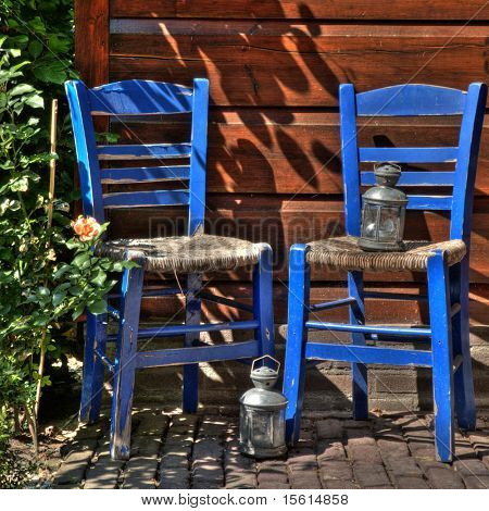 blue greek chairs outdoor with lanterns