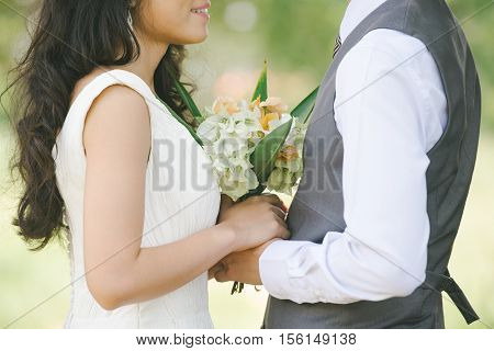 Closeup of romantic couple in love on nature background