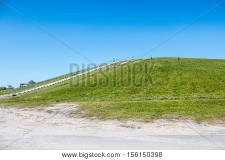 VIRGINIA BEACH, VIRGINIA - MAY 2, 2015: People exercise in the springtime at Mount Trashmore Park, the site of a former landfill.