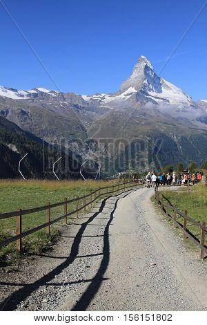 ZERMATT, SWITZERLAND- SEPT 1, 2013: Hiking trail to Matterhorn mountain on Sept 1, 2013 in Zermatt , Switzerland. It is one of the most popular mountain resorts in Switzerland.