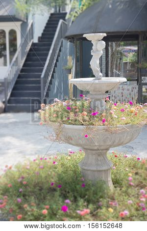 Cement garden ornament in summer stock photo