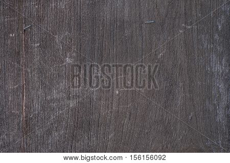 Black wood. Expensive ebony with wall texture background