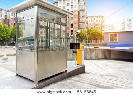 TModern city underground parking garage entrance toll booth.