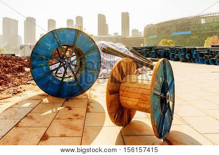 Modern construction sites and discarded cable reels.