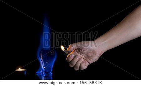 Hand Lighting A Lightbulb Instead A Candle