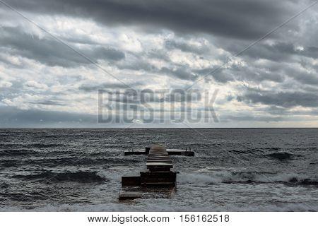 Wood bridge with sea in Budva with cloudy sky Montenegro