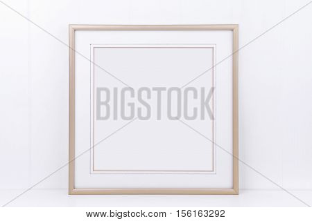 Mockup styled stock photography with plain thin square gold frame on a white background overlay your quote promotion headline or design great for small businesses lifestyle bloggers and social media campaigns