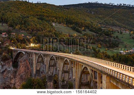 Durdevica Tara arc bridge in the autumn mountains Montenegro.