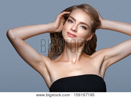 Woman Beauty. Blond Woman With Healthy Skin. Blue Background. Studio Shot.