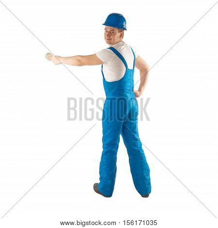 builder in blue work uniform with a brush in his hand looking at the camera and smiling isoalted on white background