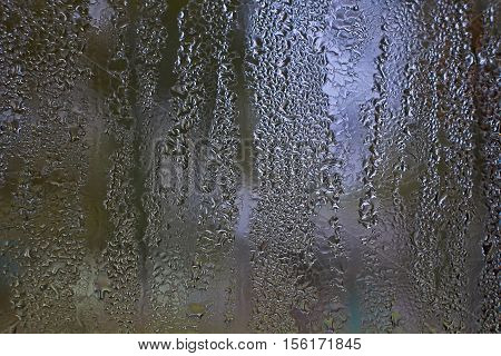 Late fall. Raindrops on a window glass.