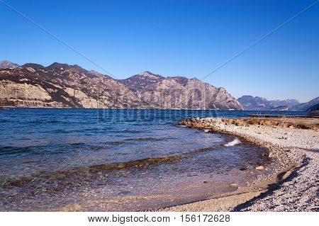 The Garda Lake in winter (Lago di Garda) with mountains near Malcesine Veneto Trentino Lombardia Italy Europe
